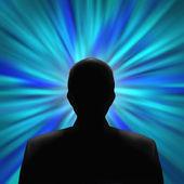 Fotografie siluetu muže v modrém vír