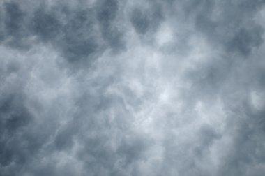 Dark clouds fill frame lighter toward center stock vector