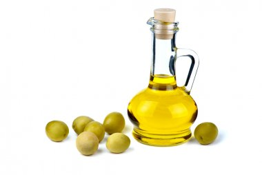 Decanter with olive oil and olives near