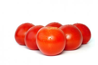 Six juicy tomatoes with drops of water