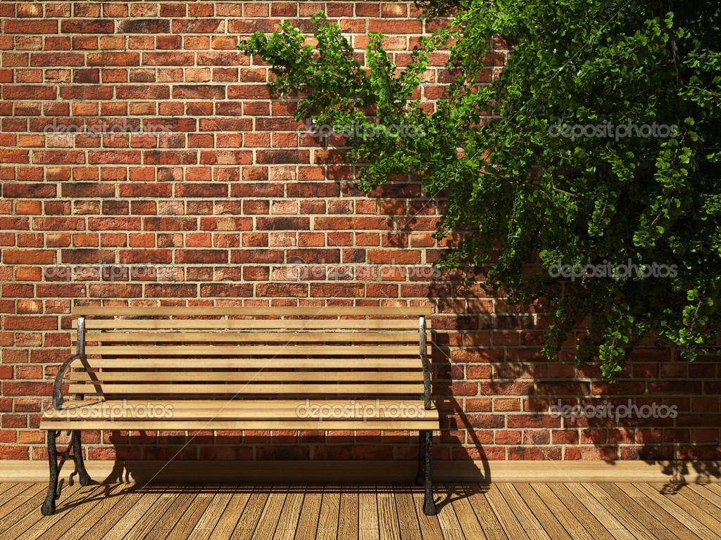 Illuminated brick wall and bench