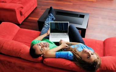 Couple have fun on laptop at home