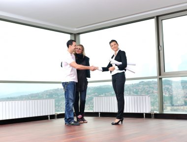 Happy young couple buying new home