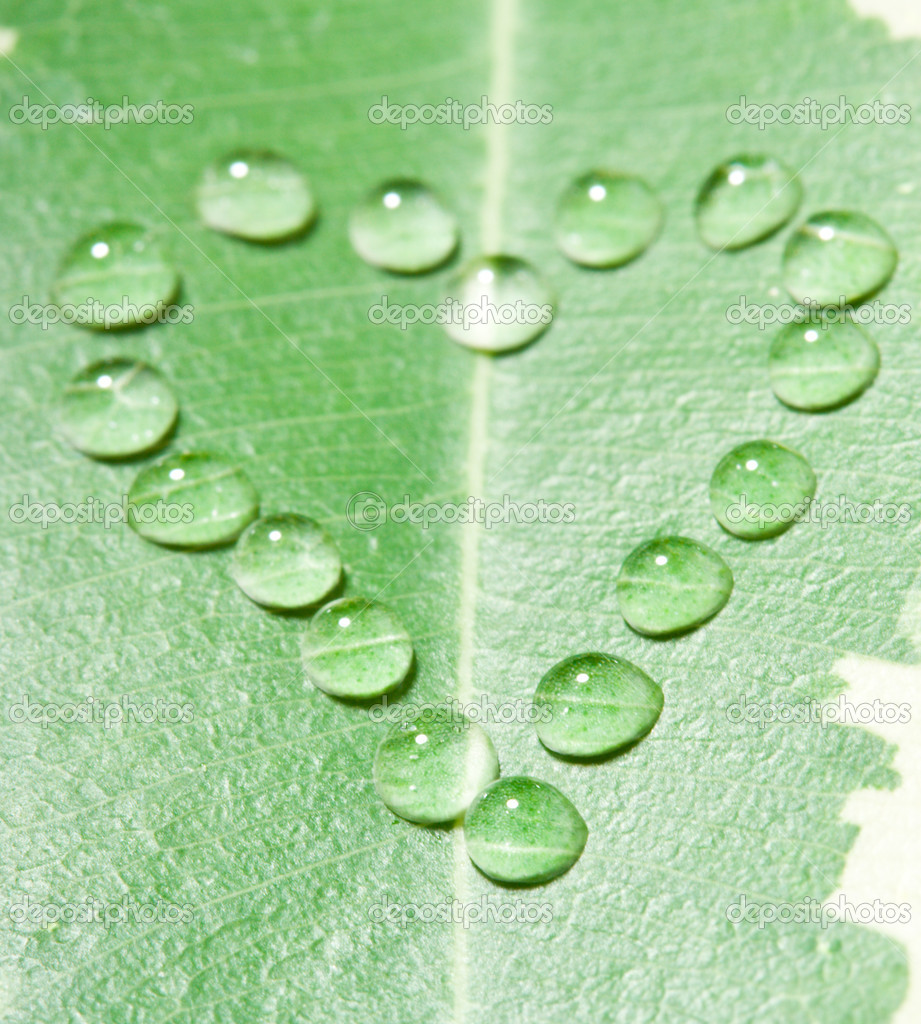 Close-up heart from water drops on leaf