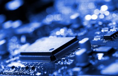 Microchip on blue circuit board