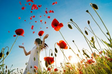Girl relaxing  in poppy field