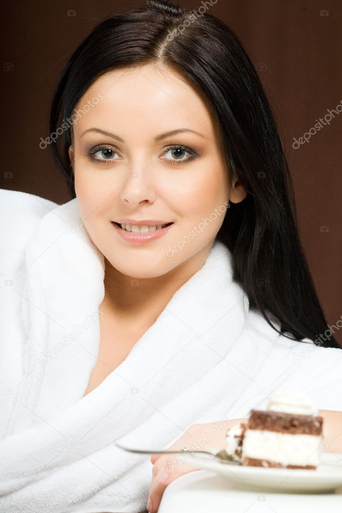 Portrait of sexy woman with pice of cake