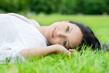 Sexy woman laying on grass
