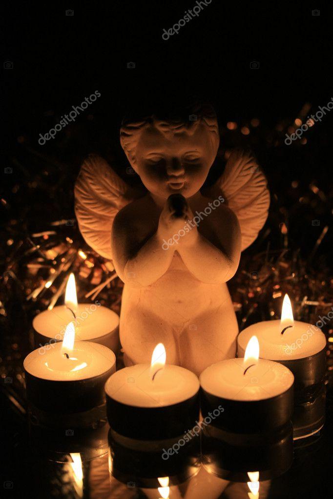 Christmas angel and votive lights