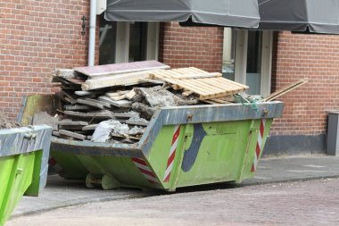 Loaded dumpster near construction site