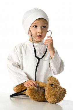 Child plays the doctor