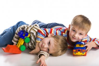 Cheerful boys lay on a floor