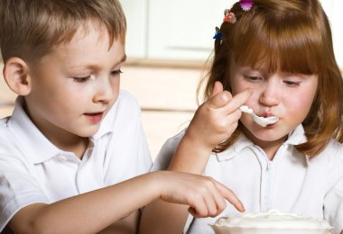 Brother and sister taste cream