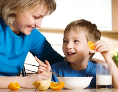 Happy mother and son in kitchen