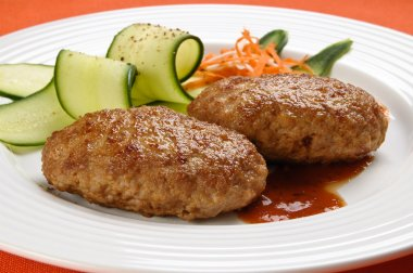 Fried steaks with vegetables