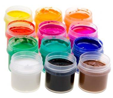 Color oil paint bottles on white