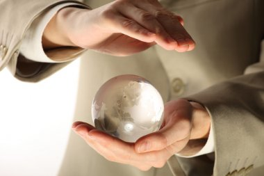 Businessman holding mini globe