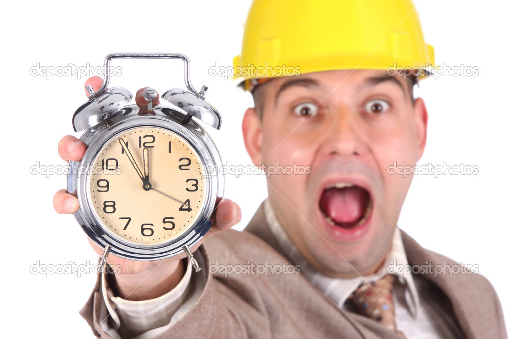 businessman looking at clock alarm stock photo vladacanon 1784886