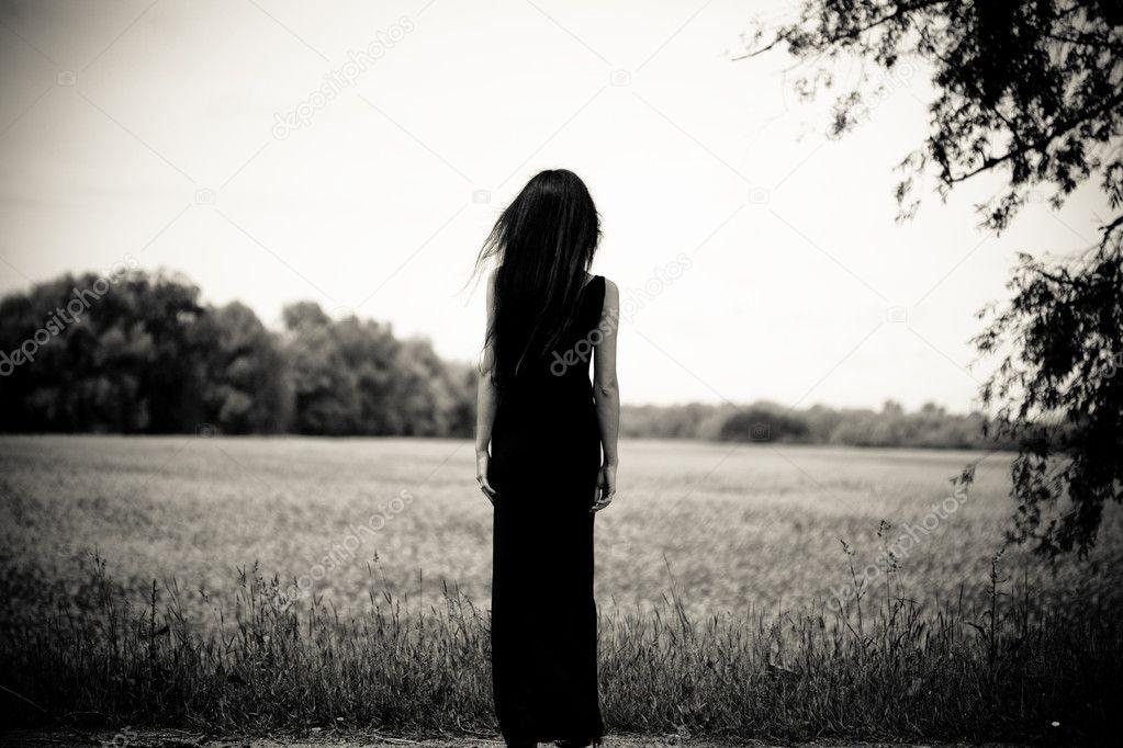 Woman is looking far away. B/W portrait.