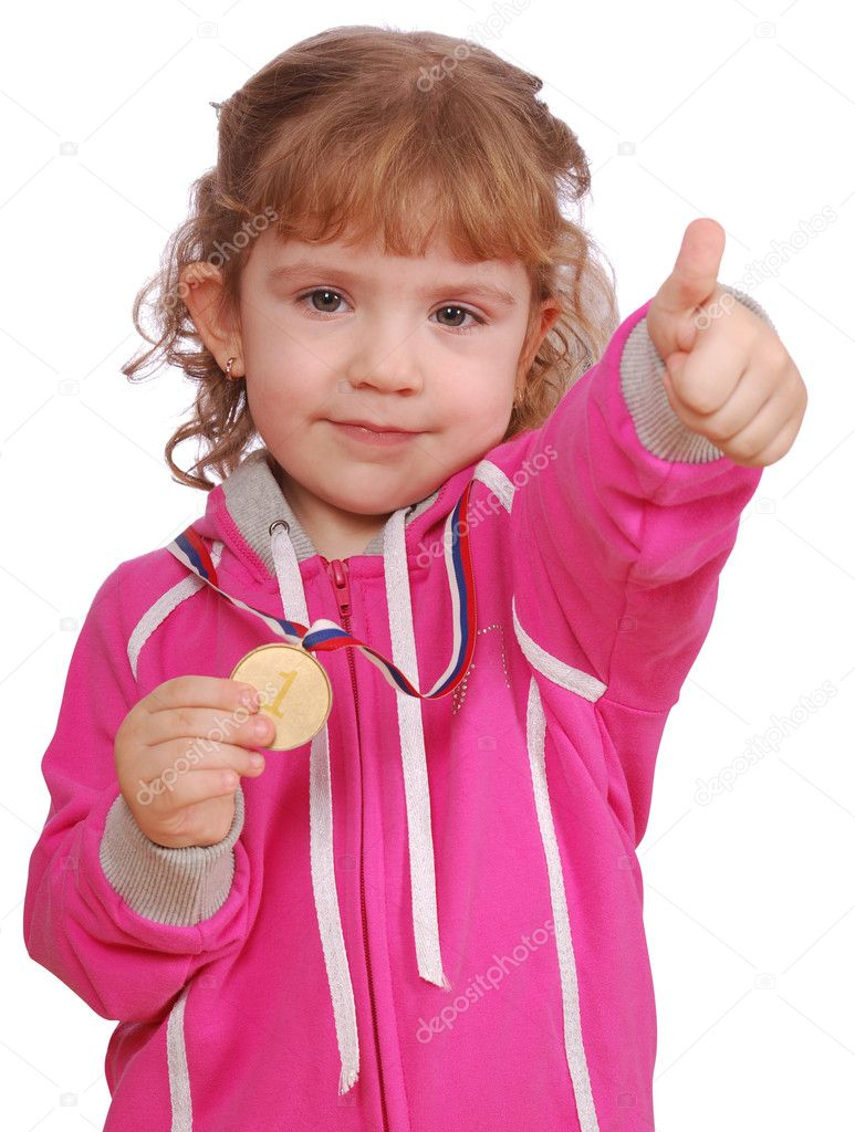 Little girl with golden medal and thumb