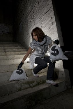 Bank robber with money sack
