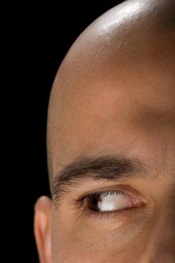 Bald man right eye