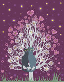 Photo In love cats on a flowering tree