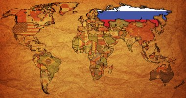 Russia on old paper map of world