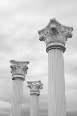 Three white columns