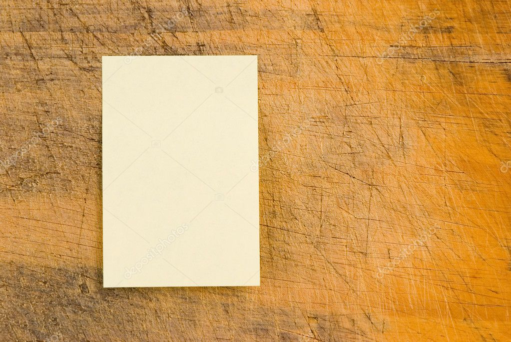 Yellow note paper on wooden background, rectangle note paper.