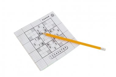 Sudoku game and yellow pencil
