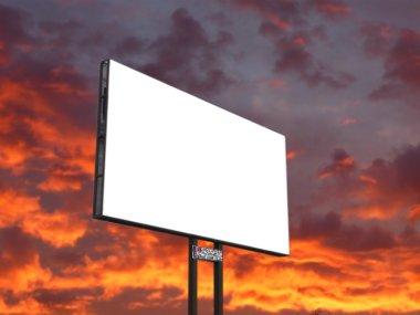 Signboard on sunset sky