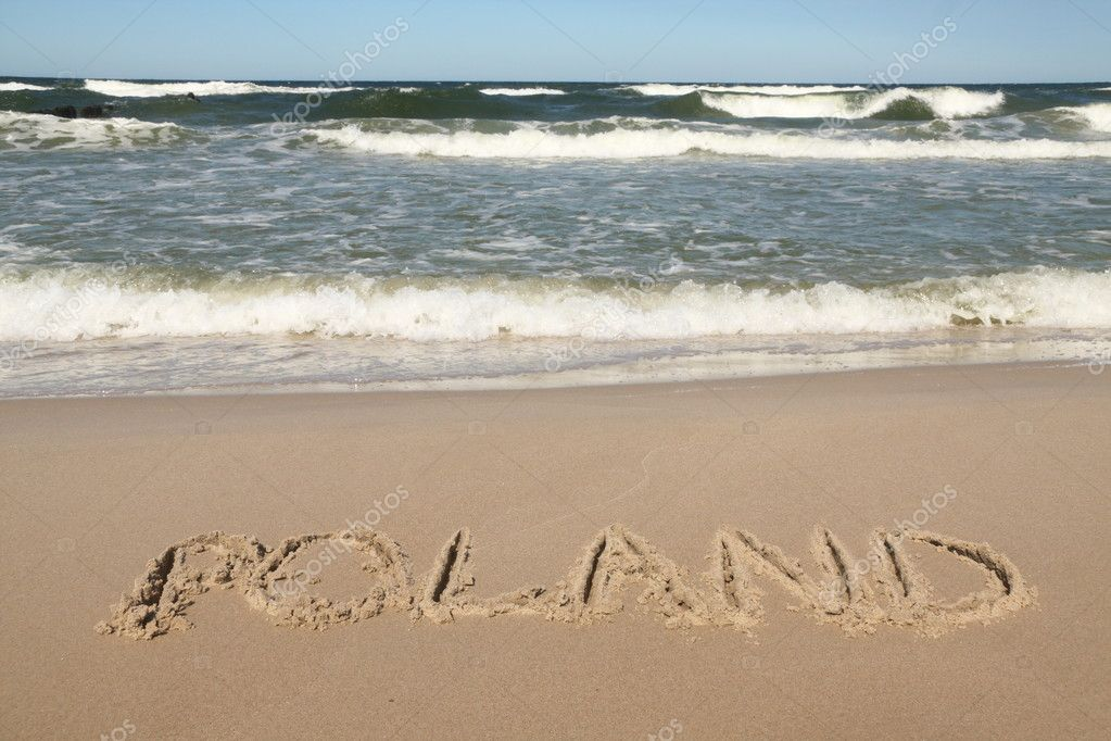 Poland - country name drawn on a beach