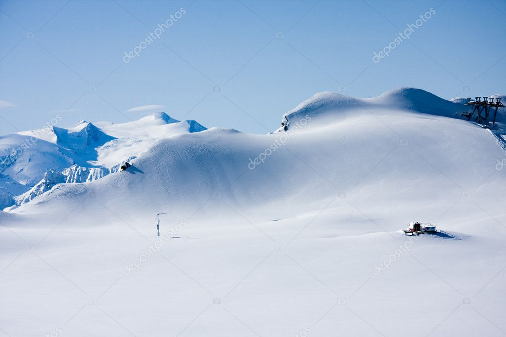 Mountains in winter and snowcat
