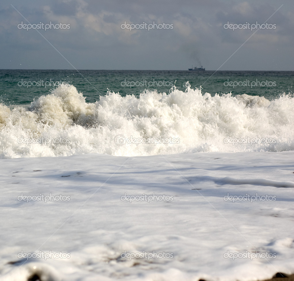 Sea wave with white foam