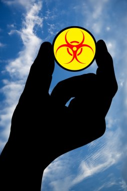 Hand with biohazard symbol and sky
