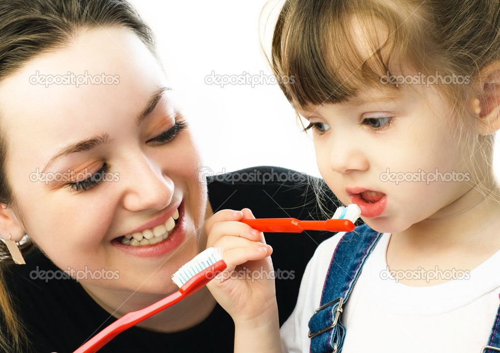 Mother And Child Daughter Brushing Teeth In Bathroom Stock