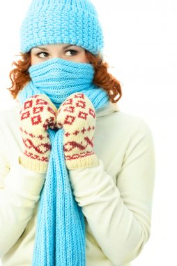 Young ginger woman wearing warm winter clothes