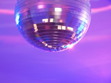 Disco ball spinning and shining purple lights stock vector