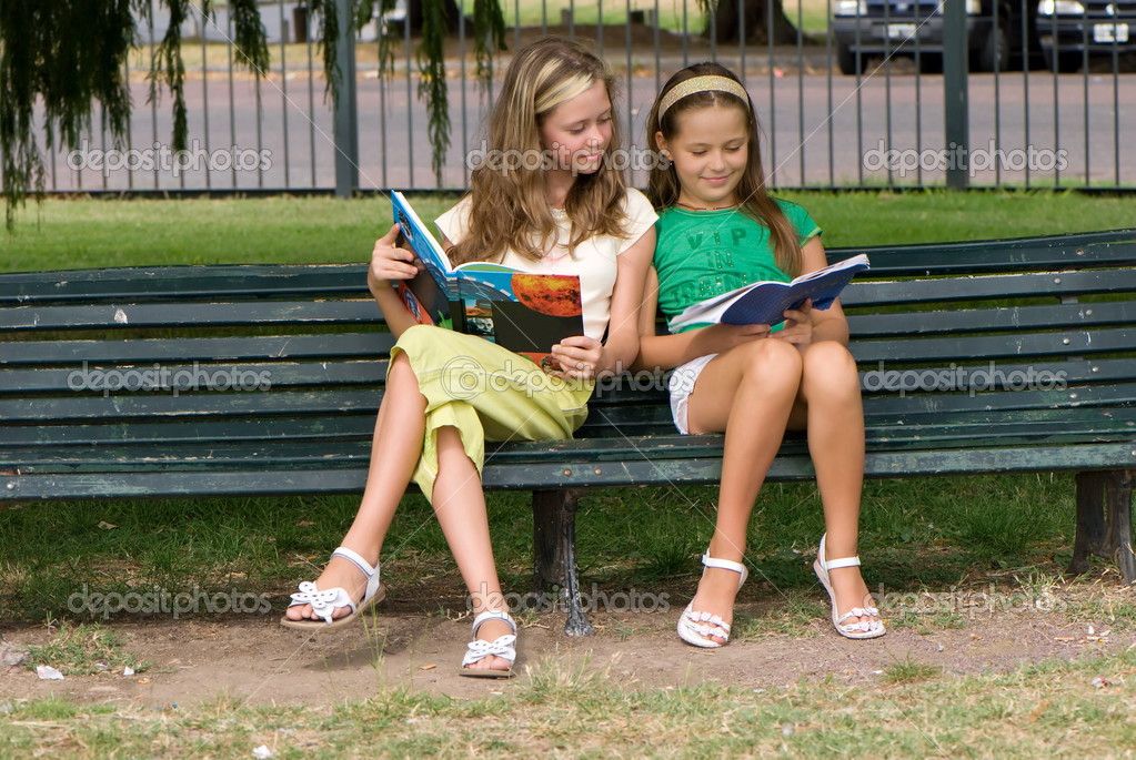 Two schoolgirls on park