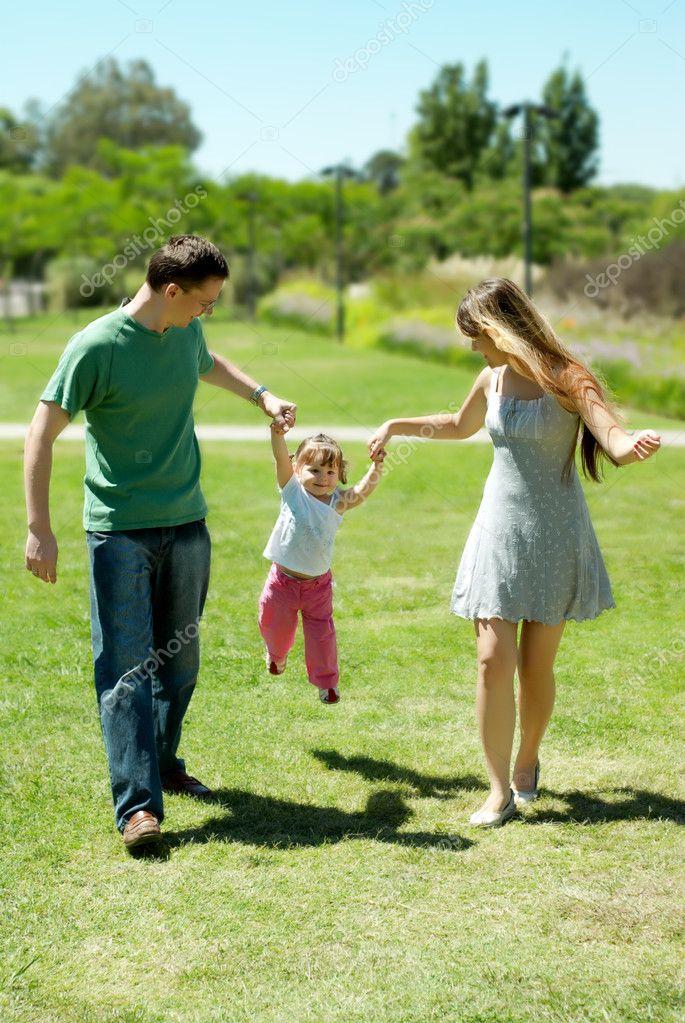 Happy family on walk in park