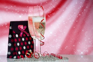 Glasses with champagne and Gift