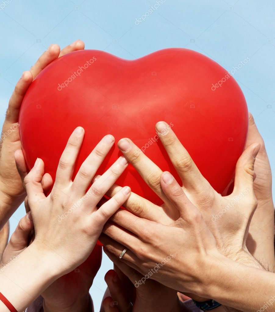 Group of hands holding heart