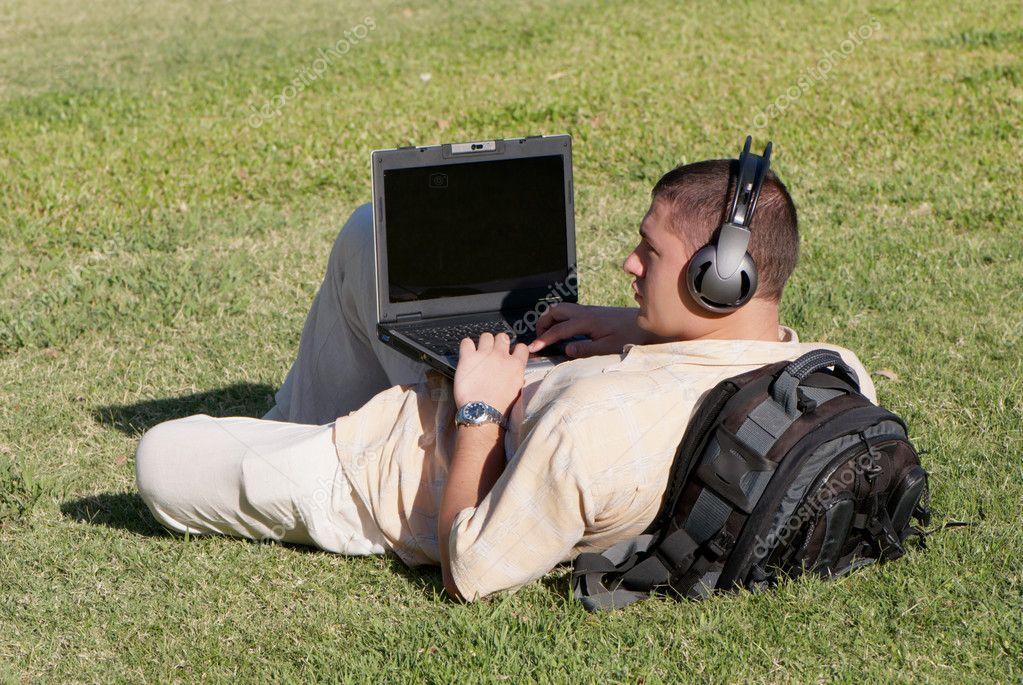 Boy using notebook outdoor