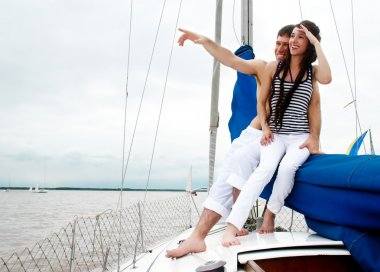 Young couple onboard the yacht