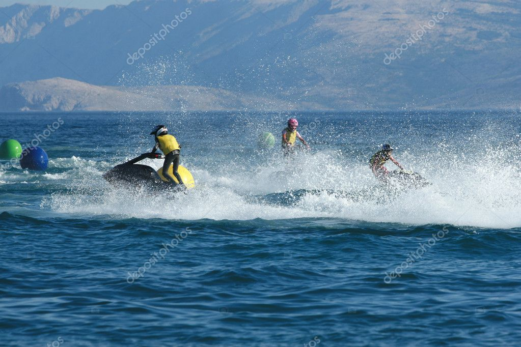 Three men on jet ski