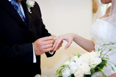 Young couple signing agreement