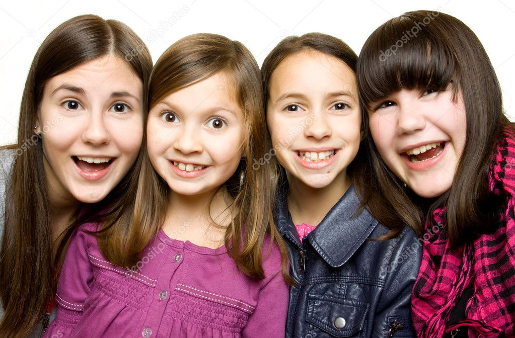 Four happy and smiling young girls on white background