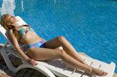 nő varádics Utazókocsi Lebzsel a medencénél