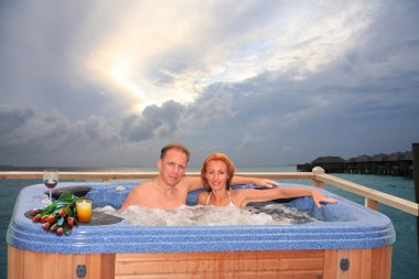 Men and woman in jacuzzi